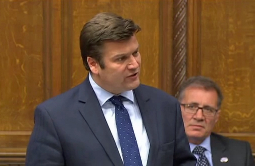 James speaking in Parliament